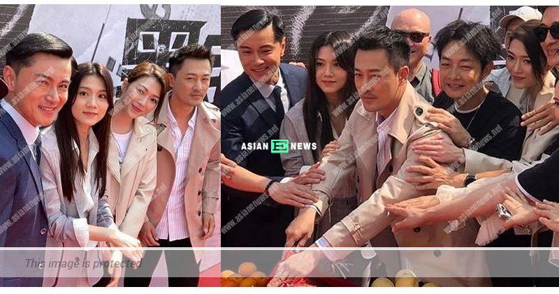 Raymond Lam leads the team to cut roasted pig at worshipping ceremony