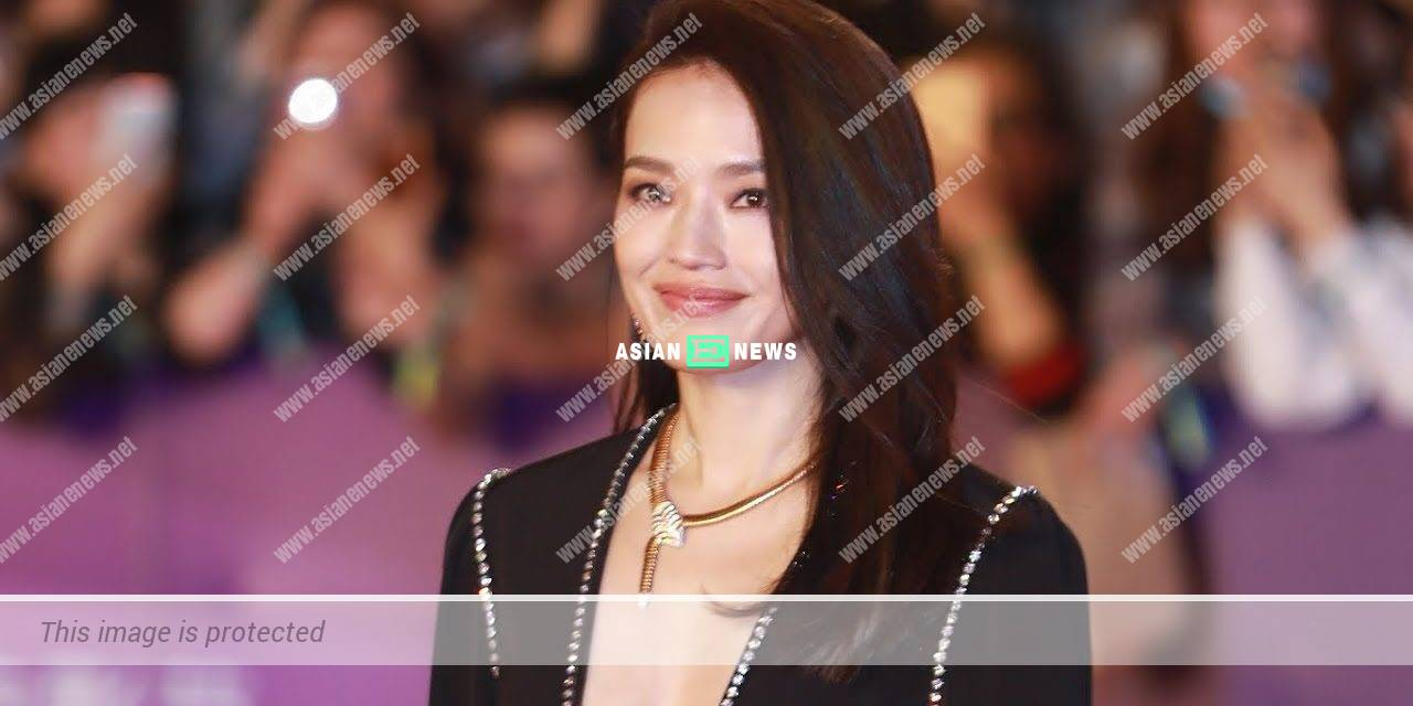 Taiwanese star Shu Qi wears a blue suit with a pair of slippers