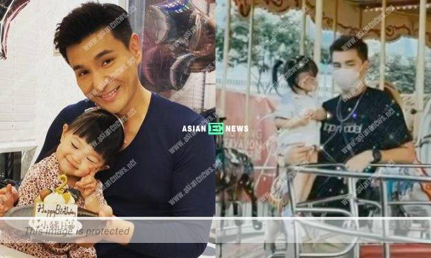 Good father Ruco Chan accompanies his daughter to go for carousel ride