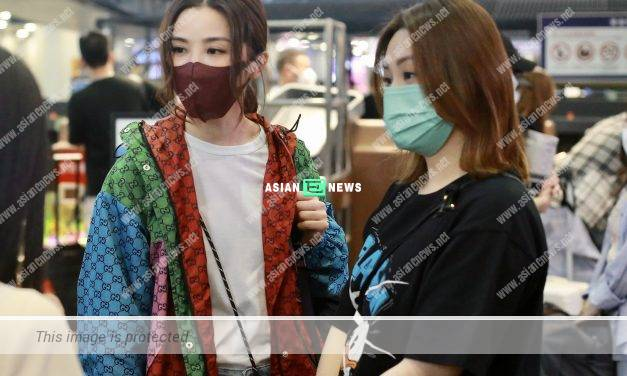 Gillian Chung is dressed in casual wear with expensive jewellery at the airport