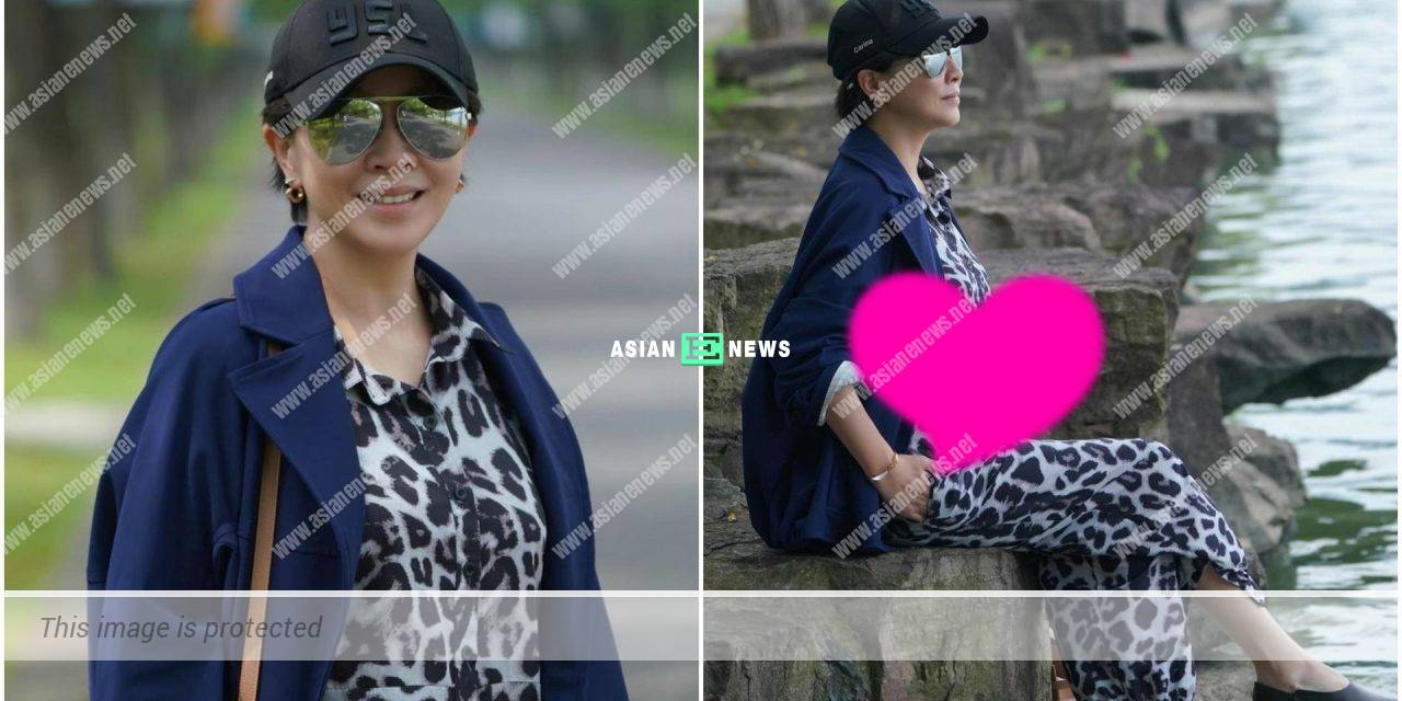 Eaten too much? Carina Lau has a big belly when sitting down?