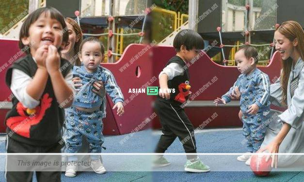 Grace Chan's younger son Yannick shows his belly at the playground