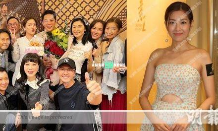 Yoyo Chen stands apart from her husband Vincent Wong in group photo