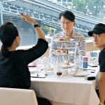 Alex Fong has high tea with a middle-aged woman